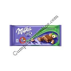 Ciocolata Milka cu alune 100 gr.